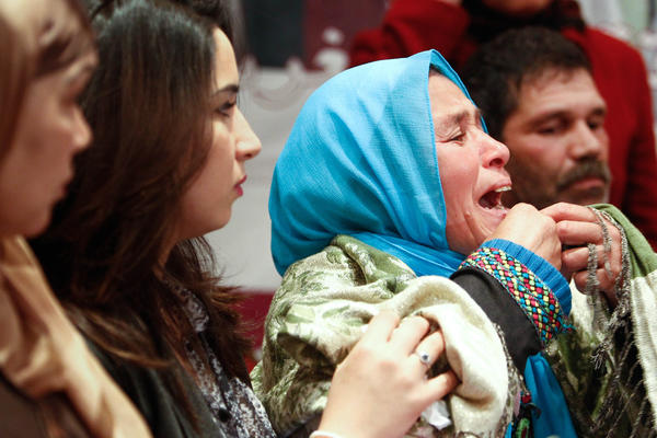 An emotional Zohra Filali, right, in April 2012 delivers a petition to the Moroccan government against the law that allows rapists to escape prosecution by marrying their victims. Her 16-year-old daughter Amina Filali killed herself after such a marriage.