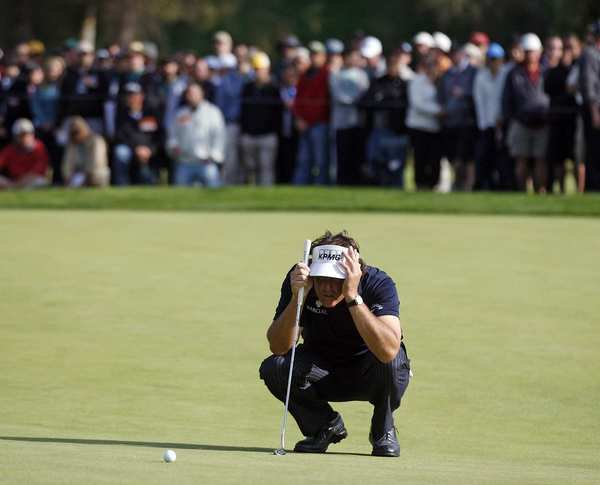 Phil Mickelson tries to find the line for a putt during the final round of the Northern Trust Open at Riviera Country Club last year.