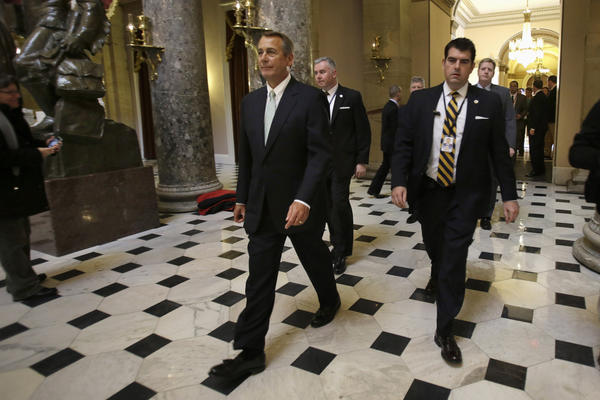 House Speaker John A. Boehner of Ohio leaves a news conference on Capitol Hill, where he discussed the debt limit. The House overwhelmingly passed a bill Wednesday to permit the government to borrow enough money to avoid a first-time default for at least four months.