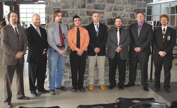 Eight students graduated from PIA Hagerstown on Dec. 22. From left, Russell Horner, Donald Wright, Shane Hope, Dustin Long, Tyler Yoder, Donovan Bricker, Sean Ashton and Joshua Williamson.