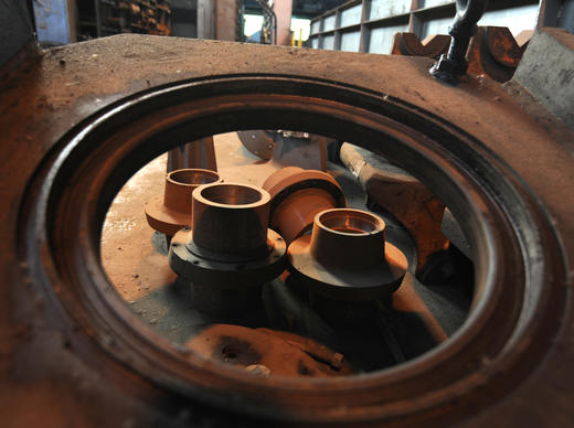 These Axle sleeves (within the large circle) are up for auction in the Tractor Repair Shop. Today was the first day of a two-day auction by Hilco Trading at Sparrows Point. Items auctioned are tools and machinery used at the former steel mill.