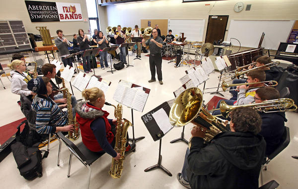Grant Manhart, center, directs members of the Northern State University Jazz Ensemble as they rehearse for a performance at the South Dakota jazz Festival on Thursday. American News Photo by John Davis
