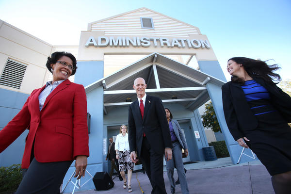 Governor Rick Scott is joined by Orange County schools superintendent Barbara Jenkins and Ocoee Middle School principal Sharyn Gabriel, along with other teachers and administratrors, for the announcement of the governor's proposal to raise teacher pay statewide in the upcoming state budget,  during a press conference at the school in Ocoee, Wednesday, January 23, 2012.