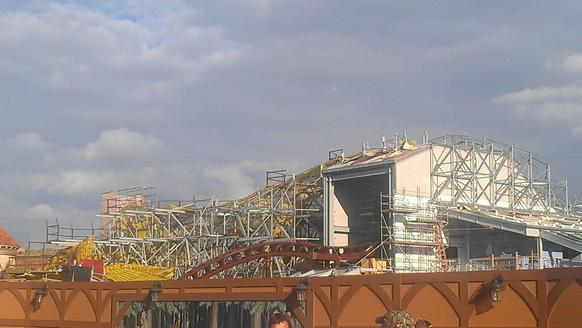 Here's a shot from New Fantasyland over the construction fence that surrounds the Seven Dwarfs Mine Train ride. It gives a better sense of the shape of the ride building.