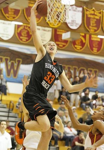 Huntington's Harley Ruder drives to the basket for a quick layup through two Ocean View defenders in game action  Monday.