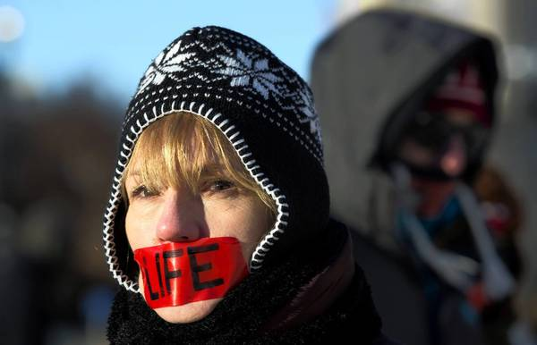 An anti-abortion activist protests Tuesday at the Supreme Court on the 40th anniversary of Roe vs. Wade.
