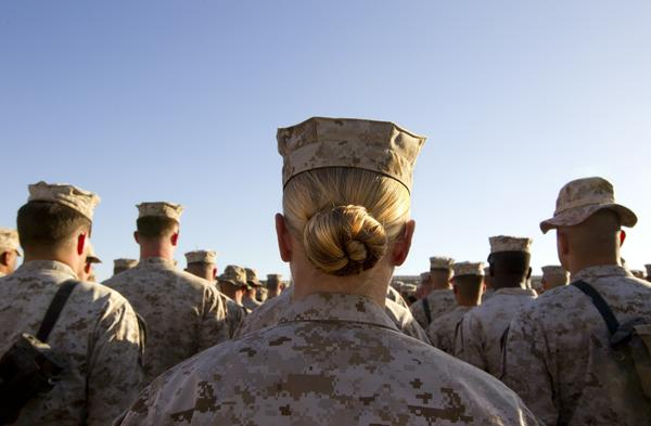 Marines stand at attention at Camp Delaram in Afghanistan in 2010. Defense Secretary Leon Panetta has removed the military's ban on women serving in combat.