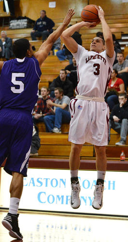 Lafayette's Tony Johnson (3) shoots for 3 points against Holy Cross' Cullen Hamilton (5) during a men's basketball game at Kirby Sports Center at Lafayette College in Easton on Wednesday.