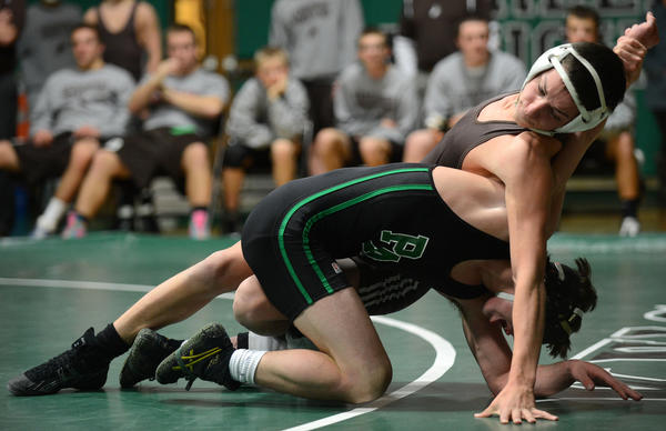 Catasauqua's Jacob Rusnock (top) and Pen Argyl's Matthew Williams (bottom) wrestle in the 126 lb. weight class. The Colonial League North Division title match was held at Pen Argyl High School Wednesday night.