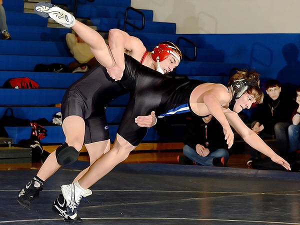 North Hagerstown's Gene Balcita takes Boonsboros Jack Riley to the mat in their 145-pound bout Wednesday at Boonsboro.