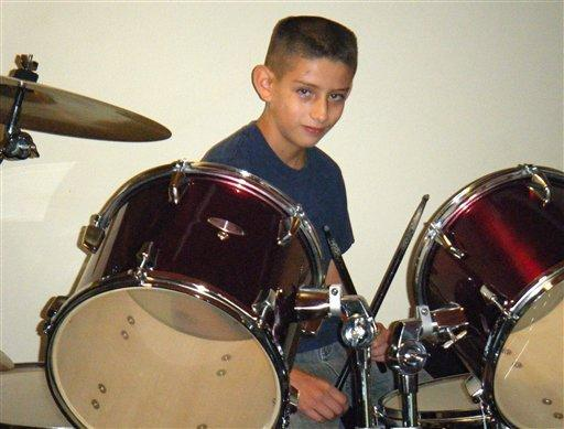 Nehemiah Griego, now 15, plays the drums in this undated family photo.