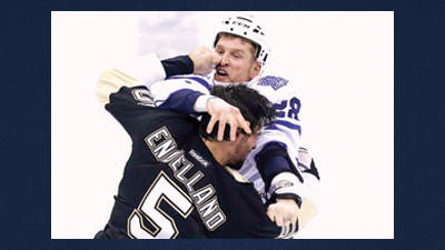 Pittsburgh Penguins defenseman Deryk Engelland (5) fights with Toronto Maple Leafs Colton Orr (28) during the first period of an NHL hockey game in Pittsburgh, Wednesday.