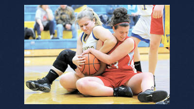Shanksville's Karianne Sulkowski and Rockwood's Katie Miller struggle for the ball. The Lady Rockets defeated their hosts, 41-38.