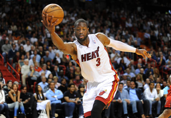 Dwyane Wade prevents th eball from going out of bounds in the fourth quarter. Toronto Raptors vs. Miami Heat. American Airlines Arena, Miami, Florida.