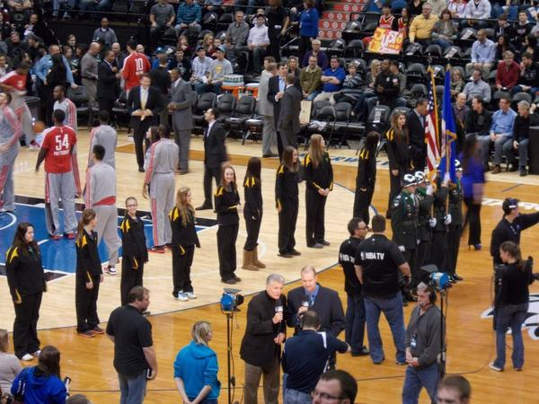 Members of the Northwestern girls¿ basketball team stand in front of the Houston Rockets before the National Anthem, as the Rockets prepared to play the Minnesota Timberwolves at the Target Center last Saturday. The Northwestern players enjoyed a fun-filled day on Saturday, which included meeting members of the T-Wolves and also practicing on the Target Center floor.