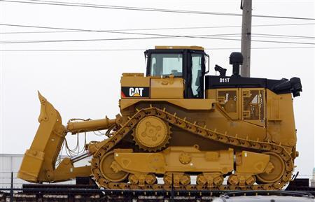 A Caterpillar bulldozer sits on a rail car outside the Caterpillar plant in Peoria.