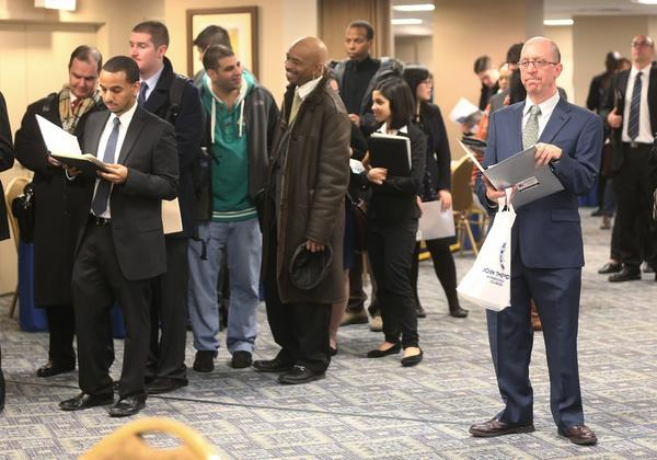 Applicants wait to meet potential employers at a Manhattan job fair last week.