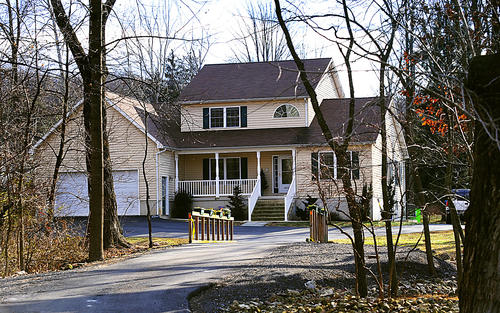 This house at 13878 Mar Penn Avenue near Waynesboro, Pa., was the scene of a police investigation that continued Wednesday after a murder/suicide took place there Tuesday evening. John Fleagle, 50, fatally shot his wife, Cathy, and himself with a handgun. Fleagle also shot his stepson, 18-year-old Mitchell Robinson, in the arm, police said.