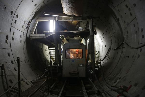 Workers construct a new subway line in Wuhan, Hubei province, China.
