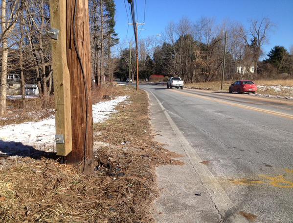 This is a photograph of the scene of a car crash in Avon Wednesday night that left three teens injured. The area of Lovely Street has been cleaned up, however, tire marks are still visible on the road.