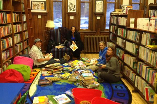 Members of the Leadership Little Traverse class of 2013, (from left) Christopher Flynn, Charis Larson, Maureen Hollacker and Amy Lauer, sort and sticker donated books.