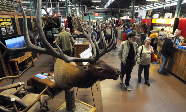 Visitors stroll through the aisles in the Guides and Outfitters Hall during the 2012 Eastern Sports and Outdoor Show at the Pennsylvania Farm Show Complex in Harrisburg on Wednesday, February 11, 2012.