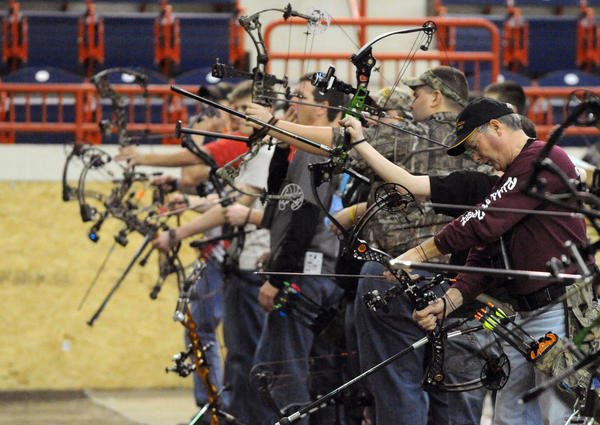 Archers take aim at animal targets in the Keystone I.B.O. Indoor Pennsylvania 3-D Bowhunters Challenge during the 2012 Eastern Sports and Outdoor Show at the Pennsylvania Farm Show Complex in Harrisburg Wednesday. The sportsman show runs through Sunday February 12th from 10 am to 5 pm.