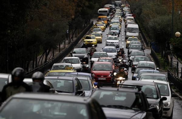 Cars jam a main road into central Athens as a strike by subway workers stretched into its eighth consecutive day.