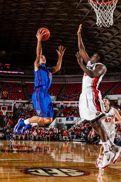 Florida Gators guard Scottie Wilbekin (5) shoots a basket in the first half against the Georgia Bulldogs at Stegeman Coliseum.