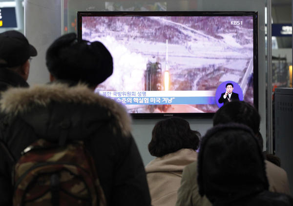 Video of North Korea's Dec. 12 launch of a multistage rocket plays on a monitor at a Seoul railway station Thursday. The launch, which placed a satellite in orbit, was considered a test of North Korea's intercontinental ballistic missile technology.