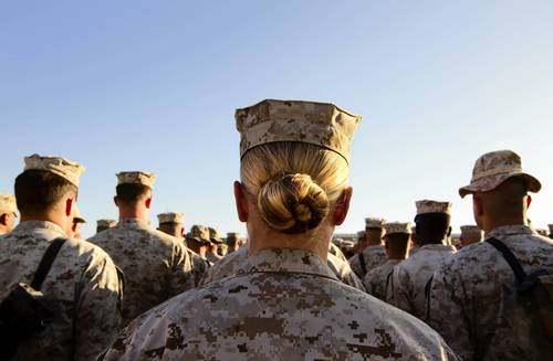 Sgt. Crystal Groves, a U.S. Marine with the FET (Female Engagement Team) 1st Battalion 8th Marines, Regimental Combat team II, stands in formation during a ceremony for the 235th birthday of the Marines on November 10, 2010 at Camp Delaram in Helmand province, Afghanistan.