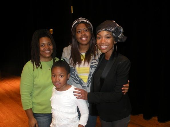 R&B singer Brandy (right) meets with music students at The Salvation Army Ray and Joan Kroc Corps Community Center January 19, 2013.