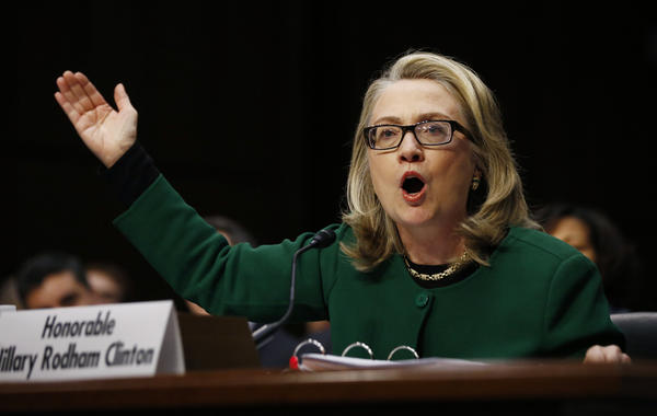 Secretary of State Hillary Clinton pounds on her table while testifying on the September attack on U.S. diplomatic sites in Benghazi, Libyaduring a hearing held by the U.S. Senate Foreign Relations Committee.
