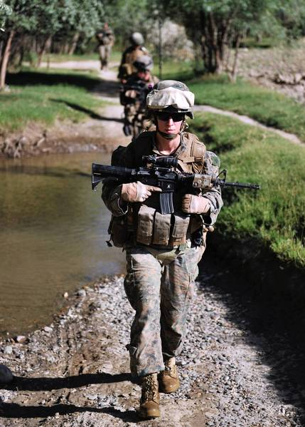 U.S. Marine Cpl. Reagan Odhner assigned in a Female Engagement Team (FET) takes part in a night patrol with Baker Company of the 1st battalion 7th Marines Regiment in Sangin, Helmand Province in this June 9, 2012 file photo. The US military officially dropped its ban on women serving in ground combat January 24, 2013 after a policy review by top commanders, Defense Secretary Leon Panetta said.