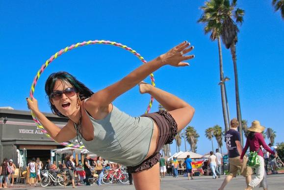 Tristan St. Jermain, 35, shows off with a hula hoop at Venice Beach Boardwalk.