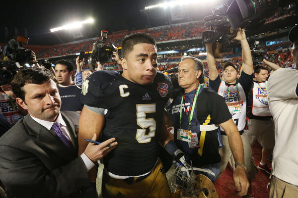 Notre Dame's Manti Te'o leaves the field after his team's loss to Alabama in the BCS championship game.