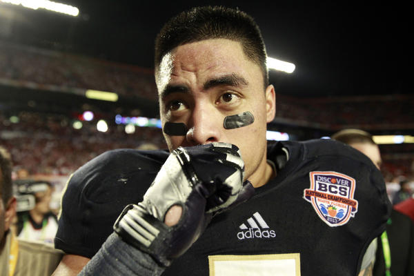 Manti Te'o leaves the field after his Notre Dame football team lost to Alabama in the national championship game.