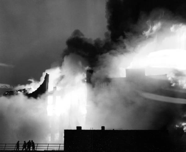 A 5-11 and 2 special alarm fire rages through a building at 614 W. Hubbard and Des Plaines Streets, containing a packing company and a bakery, on January 28, 1961. Ed Smith, Chicago Tribune