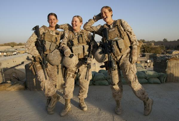 Sgt. Sheena Adams, left, Lance Cpl. Kristi Baker and hospital corpsman Shannon Crowley shown at a Marine forward operating base in Musa Qala, Afghanistan, in 2010.