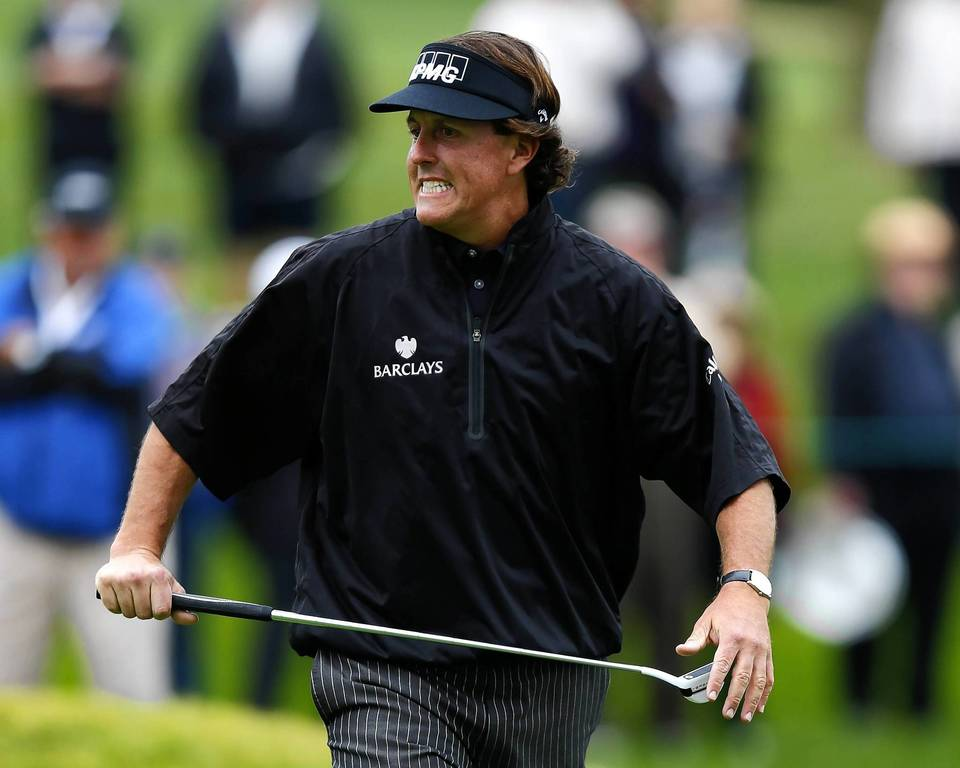 Phil Mickelson reacts last week to missing a birdie putt at the Farmers Insurance Open last week.