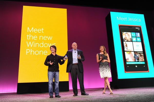 At an event in San Francisco in October, Microsoft's Joe Belfiore, left, CEO Steve Ballmer and actress Jessica Alba unveiled the Windows 8 phone. Now some numbers are in on the company's financial performance for the quarter.