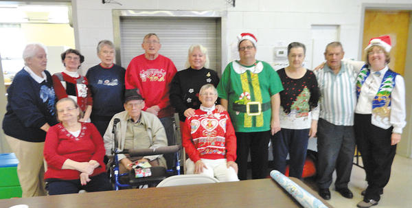Photo courtesy of Lawrence Hoffman Southeastern senior center members and staff celebrated Christmas on Dec. 21 at the center. Seated, from left, June Latimer, Bill Trasher and Betty Stottlemyer. Standing, from left, Lillian Kephart, Janet Filler, Marsha Davis, Fred Mongan, Diana Deener, Chris Fisher, Martha Drennen, Jim Kreidline and Darlene Hoffman.