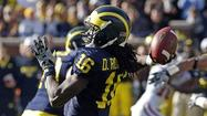 <b>Photos:</b> Denard Robinson's top high school, NCAA moments