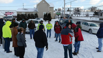On Thursday morning a group led by the PA Utilities Commission's Ron Hull (center in red jacket) met neat the intersection of 281 and Pleasant Avenue to discuss safety problems and potential solutions. Some of those represented or present were PennDOT, Somerset Borough, Somerset Borough Police, PA State Police, CSX, State Rep. Carl Walker Metzgar, and Somerset Township supervisors. At least 20 persons attended.