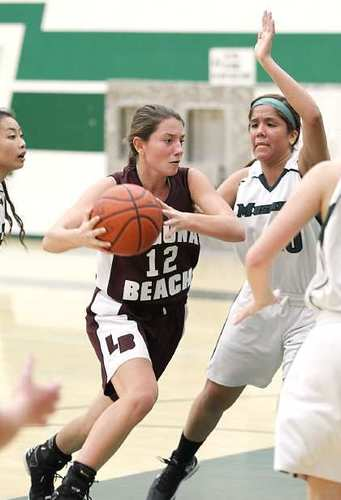 Jackie Cenan of Laguna Beach High drives to the basket against Costa Mesa.
