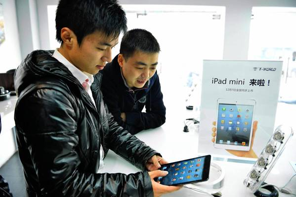 As its fortunes have climbed, it has become increasingly difficult for Apple to meet, much less exceed, investors' and analysts' sky-high expectations. Above, a customer tries out an iPad Mini at an Apple store in Hangzhou, China.