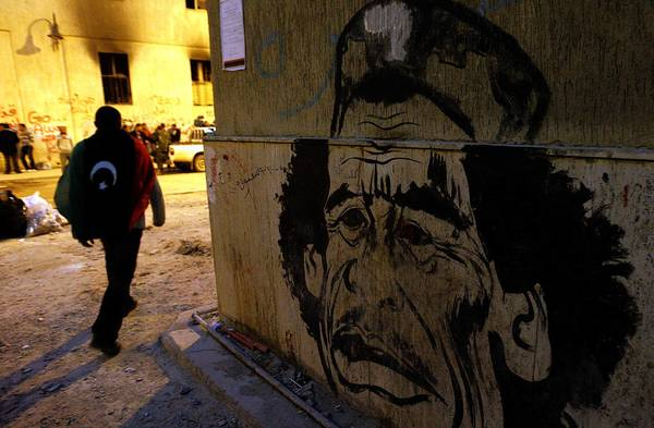 The eastern city of Benghazi, Libya, was an opposition stronghold in the uprising against Moammar Kadafi. In spring 2011, caricatures of Kadafi, such as this oen, were visible around the city.