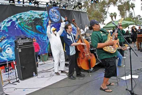 "Willie K from Hawaii joins the Wyland Blues Planet Band onstage during recent Doheny Blues Festival, which was filmed for ""Blues Planet: Sounds"" documentary."