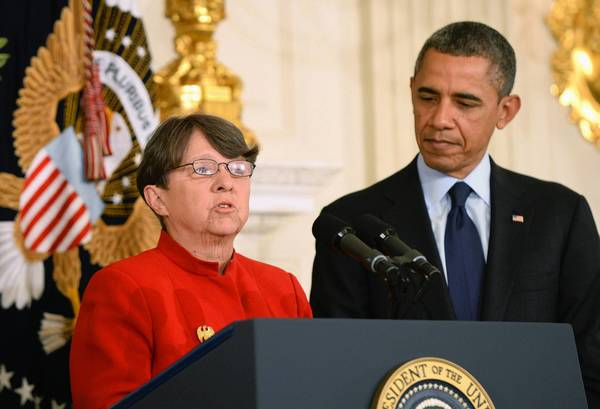 President Obama listens as Mary Jo White, his nominee to be the next chairwoman of the Securities and Exchange Commission, speaks at the White House.