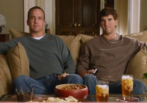 Brothers and fellow Super Bowl MVPs Peyton and Eli Manning in a DirecTV commercial.